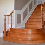 Custom maple staircase; colonial railing; curved landing.